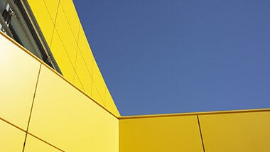 yellow bulding blue sky